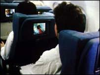 Viajeros en avión de pasajeros
