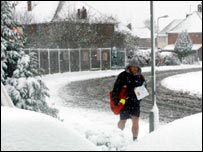 A postman in the snow in Newport Pagnell, Bucks