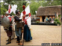 The Queen and Vice-President Dick Cheney watch a performance at Jamestown Settlement, Virginia