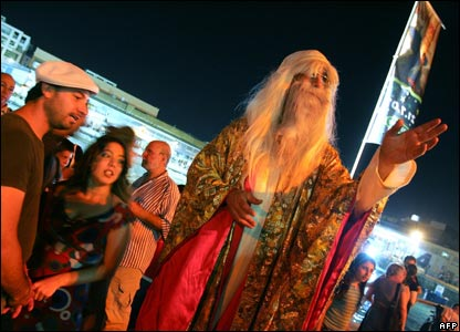 A crowd and a man dressed as the wizard Dumbledore