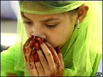 A Muslim Indian girl prays in Calcutta