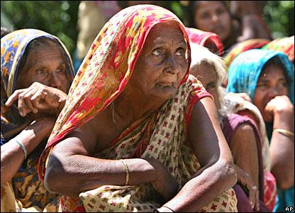 Bangladeshi women wait for aid in Manikgonj, north of the capital, Dhaka
