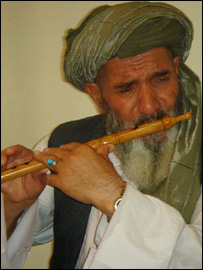 Afghan reed flute player