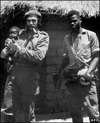 "Photo taken in 1965 of  Ernesto 'Che"" Guevara holding a Congolese boy next to a local guerrilla, during his campaign in Congo"