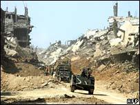 Tanks rumble through the devastated Nahr al-Bared refugee camp in Lebanon