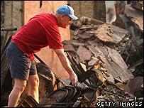 Mark Davis looks through the remains of his home October 25, 2007 in devastated Rancho Bernardo, California