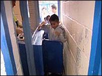 boy going through turnstile