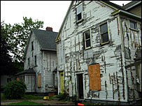 two boarded up houses in Cleveland