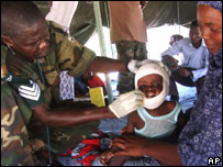 An African Union doctor attends to a wounded child, Thursday 8 November