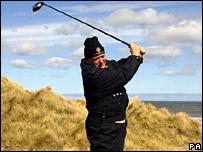 Donald Trump swinging a golf club