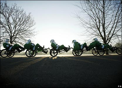 Santa Claus cyclists dressed in green