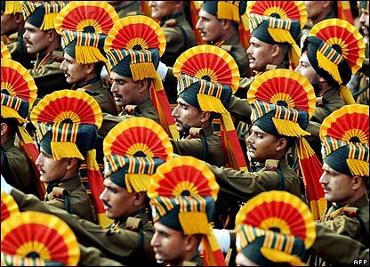Soldiers in colourful headgear marched smartly