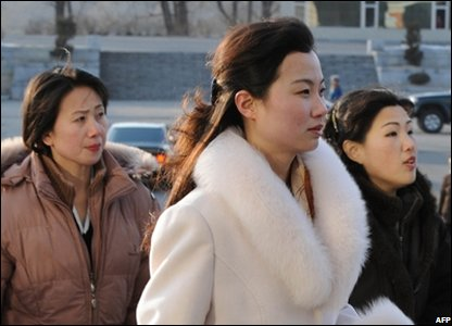 North Korean Women Arrive at the East Pyongyang Theater for a Night of First-World Revelry and Indulgence