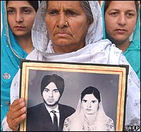 Paramjit Kaur - wife of Kashmir Singh - with their photo before he disappeared