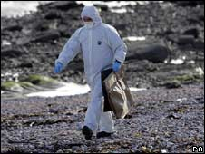 Forensic officer on beach
