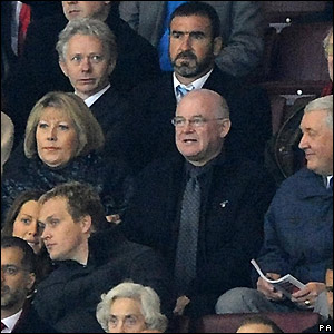 A bearder Eric Cantona watches the action at Old Trafford