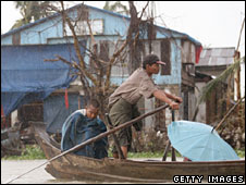 Burmese cyclone survivors on boat, Irrawaddy Delta