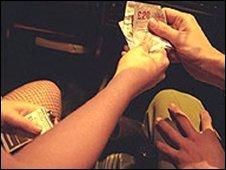 Man giving a woman money