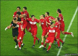 Turkey players celebrate the quarter-final win