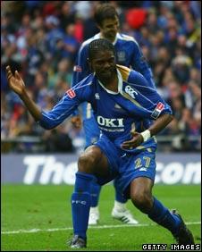 Nigeria's Kanu celebrates after scoring for Portsmouth
