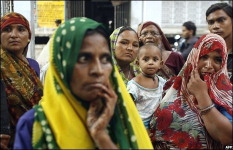 Relatives of victims wait outside a hospital
