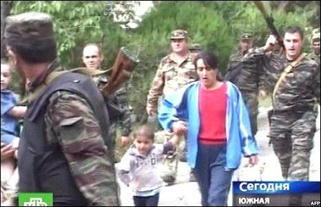 A still from Russian NTV shows South Ossetian troops evacuate women and children from Tskhinvali, Georgia (08/08/2008)