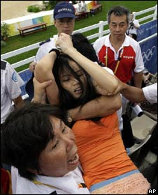 Christina Chan is removed from the equestrian event in Hong Kong