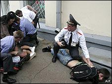 Belarussian police arrest demonstrators outside the Russian embassy on 11 August