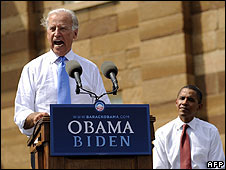 Joseph Biden addresses the crowd in Illinois as Barack Obama sits