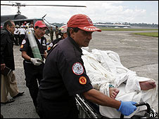 Guatemalan emergency services ferry an injured person to safety