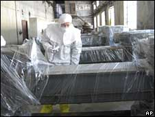 A file photo from February 2008 of a US inspector studying disabled nuclear equipment at Yongbyon plant in North Korea