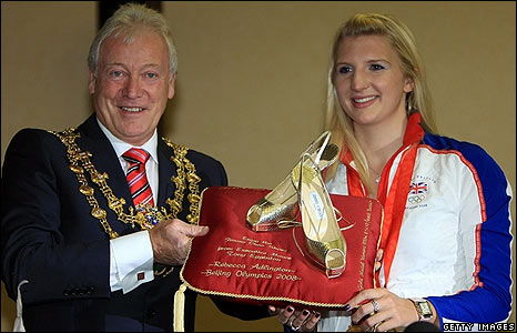 Mansfield mayor Tony Eggington presents Rebecca with her Jimmy Choo shoes