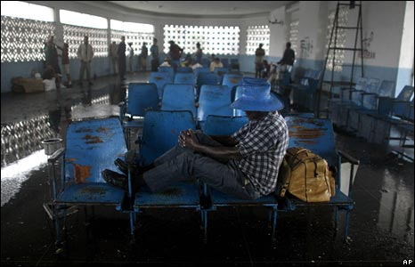 Residents take shelter in a bus station in Camaguey on 8 September 2008