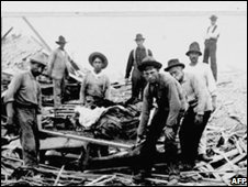 Men carry out bodies from the wreckage after a hurricane in Galveston, Texas, in 1900
