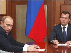 Vladimir Putin (L) and Dmitri Medvedev