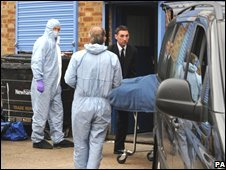 The body of Sehrish Waqar Sheikh is removed from the scene in Balaam Street, Plaistow, east London