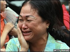 Sister of Nguyen Viet Chien cries as she leaves the court in Hanoi on Tuesday