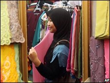 A Muslim woman in Malaysia in a textiles shop