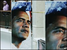 An Indonesian woman looks at a poster of Barack Obama, 5 November 2008