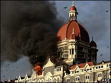 Flames and black smoke billow from the Taj Mahal Palace hotel, Mumbai
