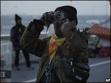 An anti-government protester outside Bangkok airport