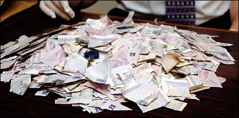 £10,000 in cut-up £10 and £20 notes
