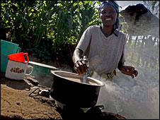 A woman cooking breakfast in Nyamikamba, Rwanda (Photo Kate Holt/Oxfam)