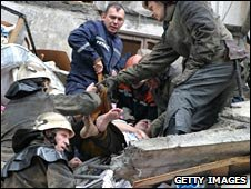 Rescuers carry a man from a destroyed apartment building after a gas blast in the  Ukrainian city of Dnipropetrovsk in 13 October 2007
