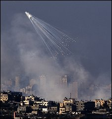 Israeli artillery shells explode over the Gaza Strip