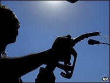 A customer at a petrol pump
