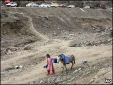 An Afghan girl leads her donkey to get water in Kabul last Sunday