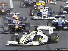 Jenson Button leads at the start of the Australian Grand Prix