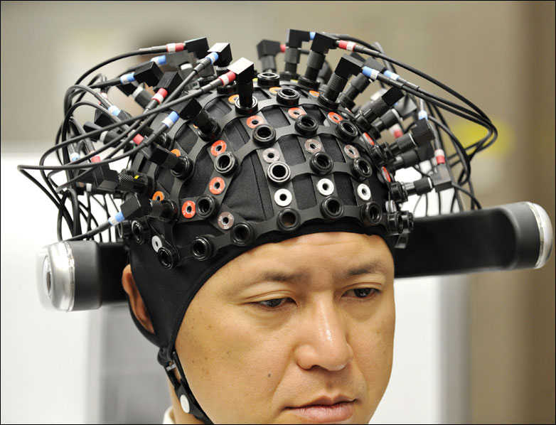 A man wears a brain-machine interface