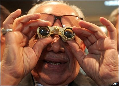 An Iraqi investor uses his binoculars to look at the dealing board at the Iraq Stock Exchange in Baghdad on 31 March, 2009